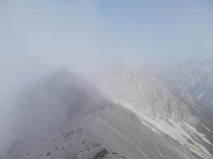 Nuvole sulla punta più alta delle cime Postegae